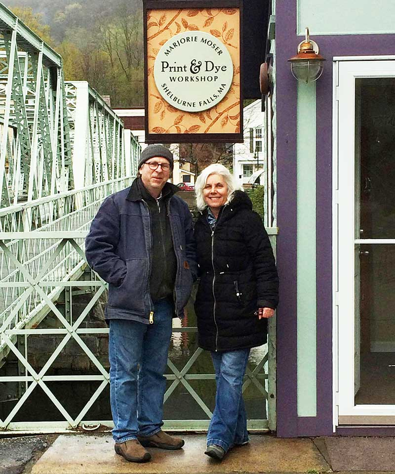 Marjorie and Peter Moser in front of shop